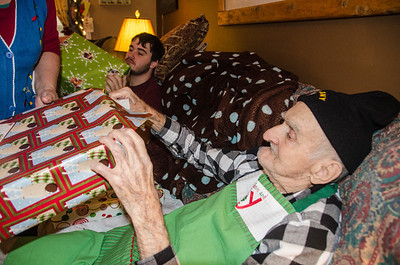 Grandpa opening his gifts