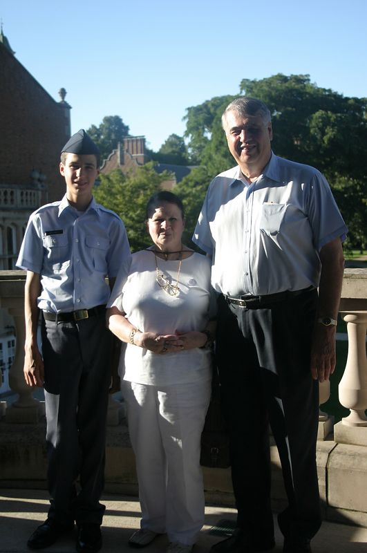 Evan with maternal grandparents on library steps September 19