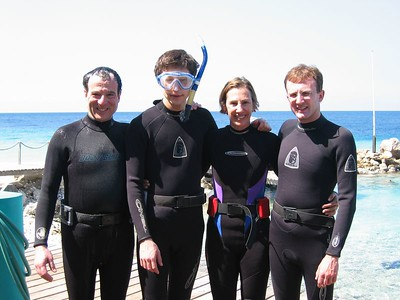 Family suited up on dock