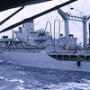 March 1965: The USS Magoffin (APA-199) conducting underway replinishment (Fueling) possibly from the USS Ponchatoula (AO-148) Oiler during its journey from Hawaii to Okinawa.
