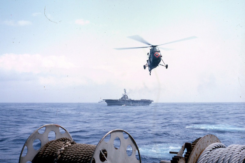 March 1965: As seen from the USS Magoffin, UH-34D helicopters of HMM-161 operate from the deck of USS Valley Forge (LPH-8.)