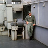 March 1965: On board the USS Magoffin (APA-199) en route to Okinawa from Hawaii, Capt. Kenneth W. McCoy poses for the camera during the long journey.  Capt. McCoy was an Air Liaison Officer attached to the 2nd Battalion 4th Marines.