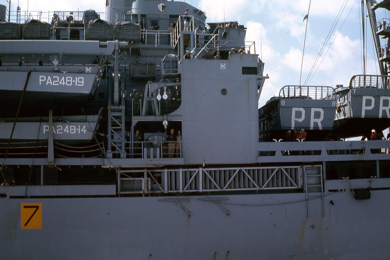 March 1965: Operating side by side while enroute to Okinawa, the USS Paul Reviere (APA-248) can be seen port side of the USS Magoffin (APA-199). The two ships are cabling materials and personnel back and forth.