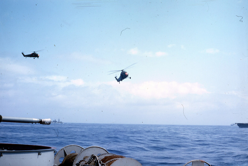 March 1965: Seen just off the Starboard side of the Magoffin, the UH-34D helicopters of HMM-161 operate from the deck of USS Valley Forge (LPH-8.)