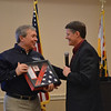 Receiving a flag that was flown in front of Cole Field House (Univ of Maryland - his Alma Mater)