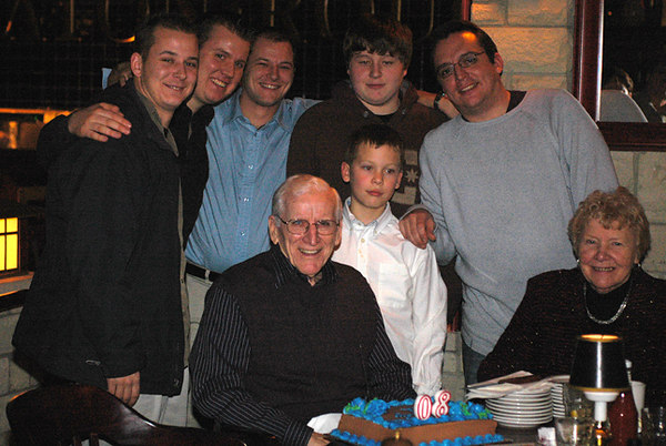 Surrounded by grandsons.