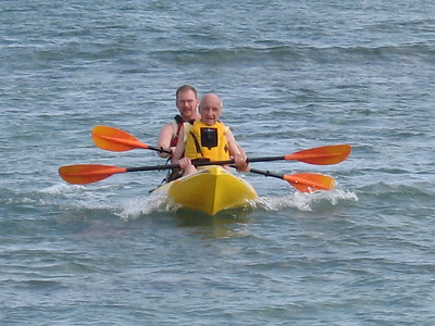 Dad and Allen surfing in on the waves