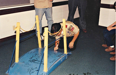 Michael signing the bridge after receiving his Arrow of Light - 1995.