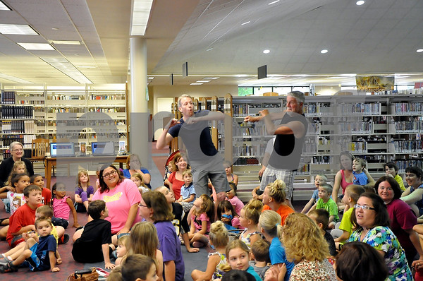 -Messenger photo by Joe Sutter<br /> <br /> Adam Fritz, left, and Mark Fritz show off their dancing skills, as Dan Wardell gets the grown-ups involved in his Reading Roadtrip story time.