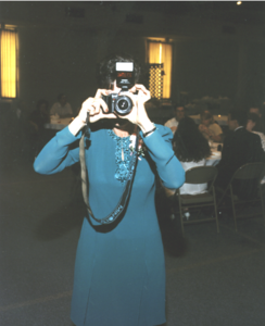 Vickie taking a picture of the photographer at Amy and Matt's wedding.