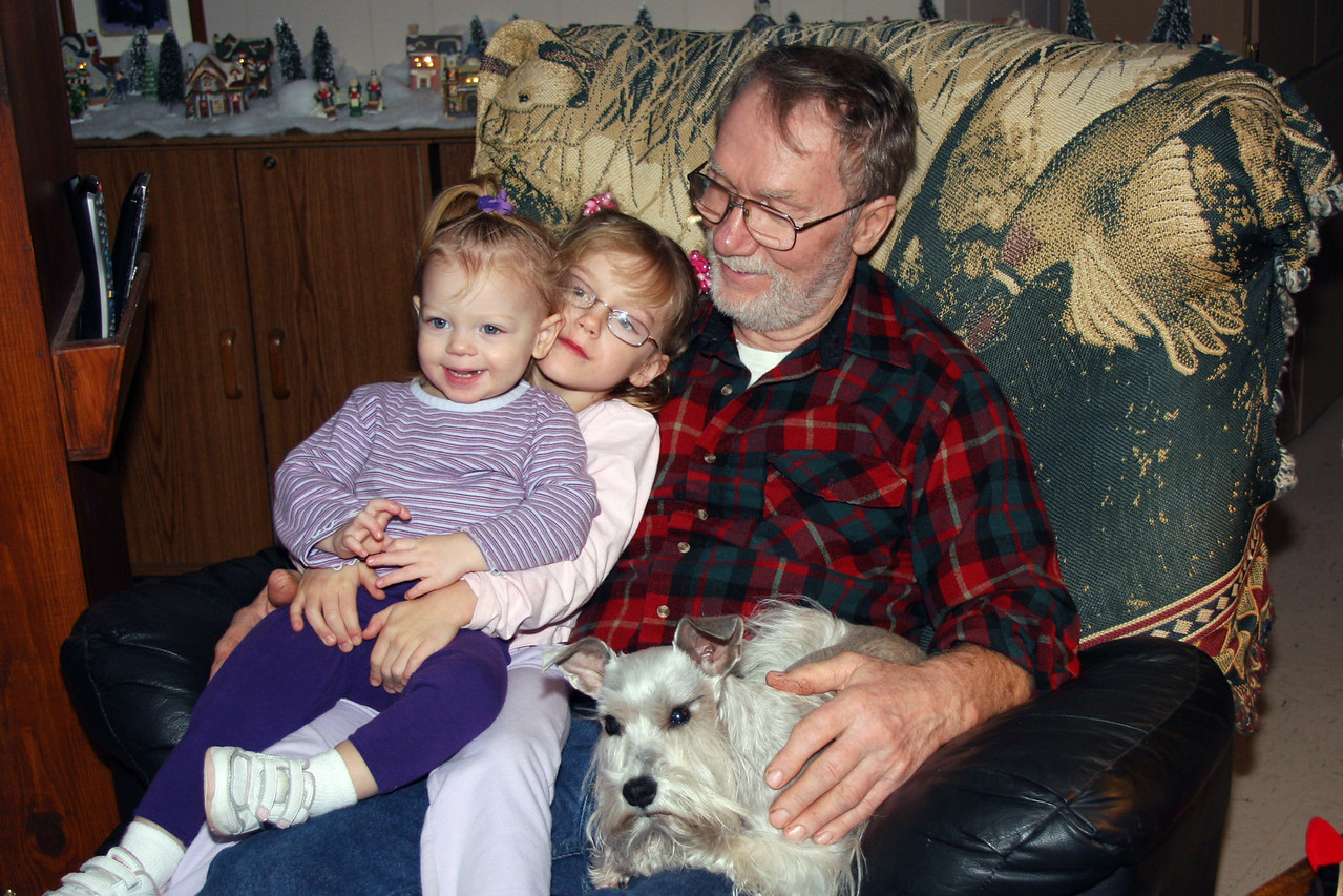 Grandpa has his lap full of Granddaughters Krystall and Jessilyn.  And of course, Leibe.