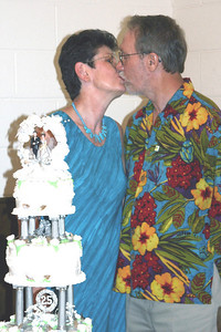 25th Anniversary kiss.  Cake done by Verlinda Walker.