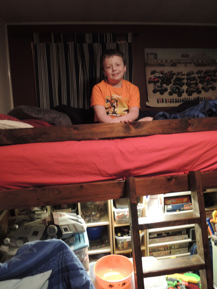 Connor perched on his bed.