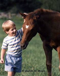 David's love for animals was evident at a very young age. This was taken in the summer of 1984 so he is about three and a half here.