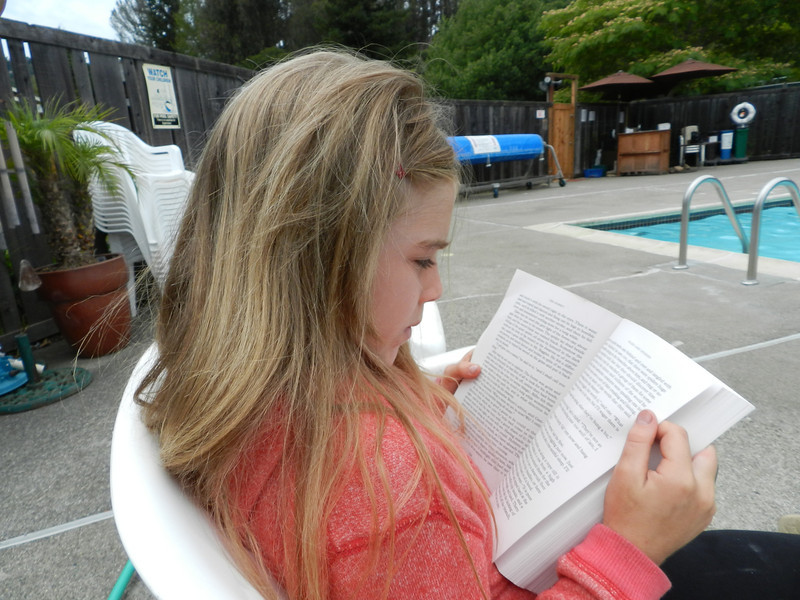 """Sofia reading """"The Hobbit"""" while the rest of the gang went swimming"""