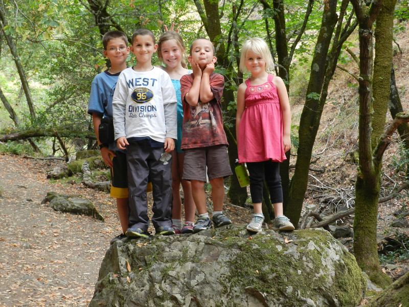 Austin, Charlie, Sofia, Gregory and Allegra on a large rock