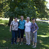 Betsy Schott, Diane, Debbie, and Nadine enjoy a moment at the tree dedicated to Bill's memory.