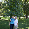 Diane and Debbie stand in front of the tree that was donated in memory of Debbie's husband Bill Schott.