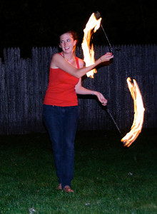 Molly starts her fire dance