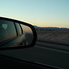 my attempt to capture the beautiful evening colors ahead and in the rearview mirror