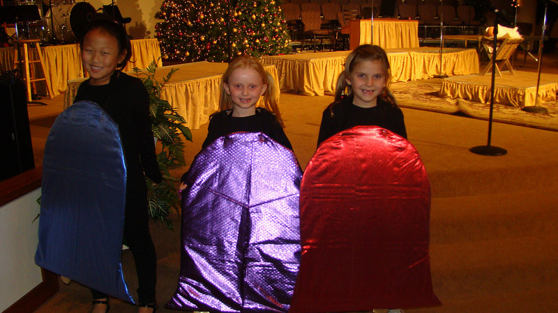 Abby as a Bell in the TCA Christmas musical(with Maggie and Makenna)