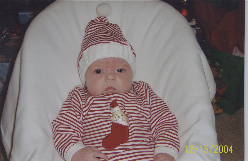 Camden wearing Emma Grace's Christmas outfit.