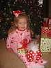 Camden posing with the presents...she can't wait til Christmas morning!