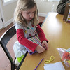 Lena weaving her first pot holder.
