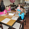 Art project at the party.  <br /> Lena, Lauren, Lilly & Norah.