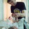 Cleaning, with a smile!: Wade's first time changing a baby!
