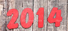 """2014"" number on old wood background"