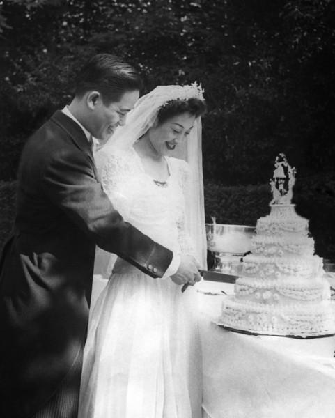 Mom and Dad cutting cake copy-bw-conv