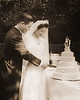 Mom and Dad cutting cake-sepia