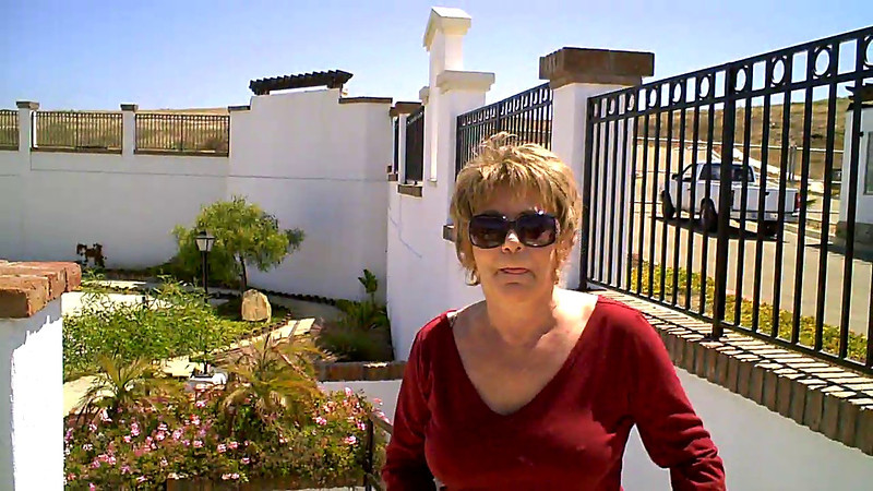 Diane gives me a sales pitch, at my request, for a home in El Descanso.