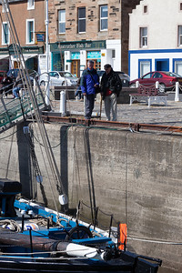 Dickie and David looking at a boat, Anstruther