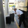 "JSturr Photographer -  <a href=""http://www.jsturr.com"">http://www.jsturr.com</a><br /> <br /> The bus driver loading up the compartment."