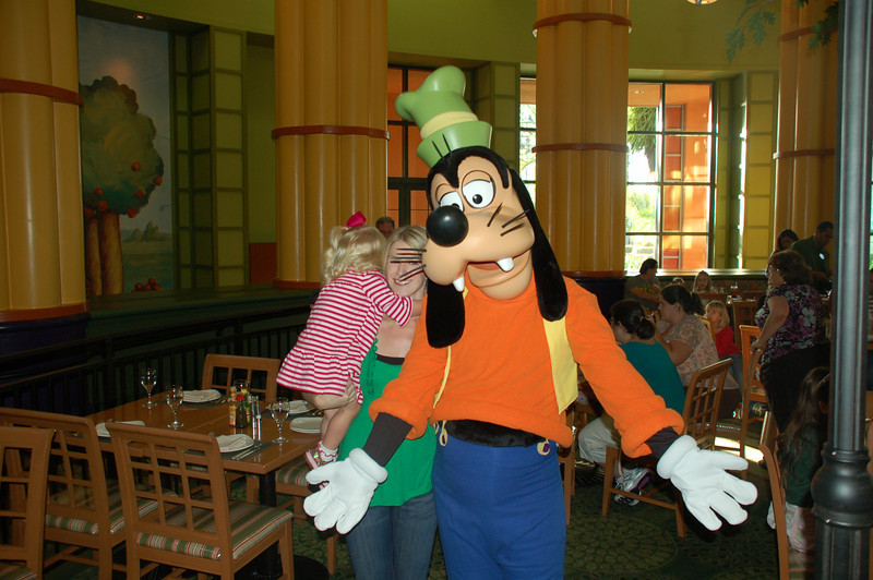 First impression of a Disney character up close, but by the end she was loving Goofy and Pluto!