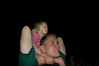 Hallie intently watching the fireworks show on daddy's shoulders.
