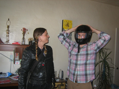 Djuna arrived by motorcycle, and Abe tried on her helmet.  Sept 2007.