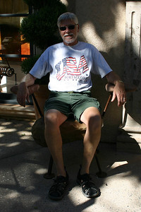 On the chair made of stone at Tlaquepaque Arts & Crafts Village in Sedona