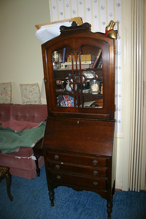 Donlea Drive Walnut Desk With Glass Door Contents