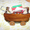 Gregory's suspicion is that this small cart (about six inches in length) was made by his grandfather Ernie Smith.  It looks like his handiwork.<br /> <br /> This is the end of the Gallery Walnut Glass Fronted Desk.  The next Gallery is the Kitchen.