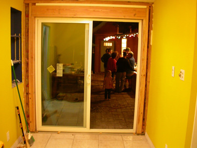 The chicharrones pizza came out great, but the only photo I got was with my cell phone and is in another album.  We did get the door in, but only with a few temporary screws for the night so we could come back and seal it and finish the header the next day.