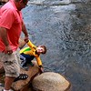 Luke dipping in the river