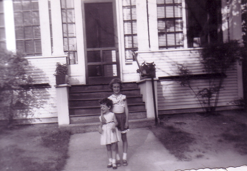 Laurie Jo and Beth Johnston in front of Grandparents' Nicholson's home