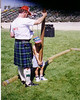 Douglas Walton learning to toss the caber at the Campbell Scottish Games