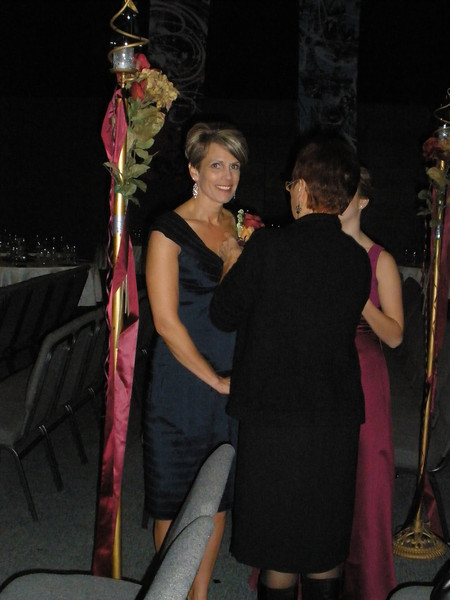 Julie - getting her flower pinned on by her mother, Vadis