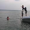 Matt tossing Mason into the lake