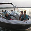 The teenagers in Greg's new boat