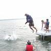 Diane pushing Matt into the lake